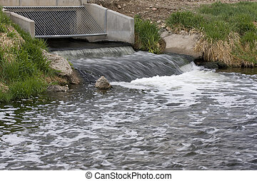 Processed and cleaned sewage flowing out from water...