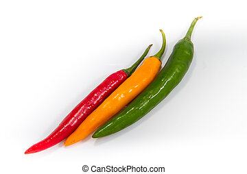 Red and green and yellow chilli peppers on white background