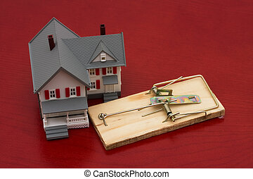 Mortgage Trap - A mouse trap beside a house on red...
