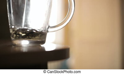 Pouring a mug of herbal tea