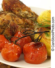 Grilled chicken with tomatoes, closeup - Grilled tomatoes on...