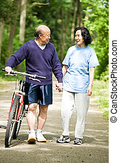 Senior active asian couple - A senior active asian couple...