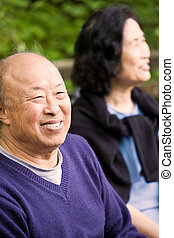 Happy elderly couple - A shot of happy elderly asian couple...
