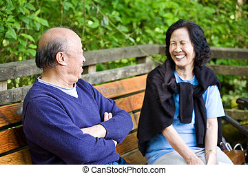 Happy mature couple - A happy mature asian couple having fun...