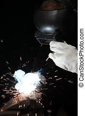 Welder and Sparks on Black Background