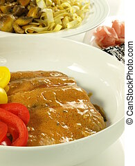 Indian cuisine: salmon in curry - Salmon in curry sauce with...