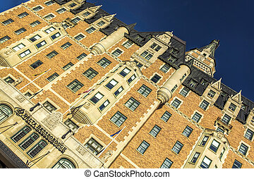 Signature Hotel - Details of a brick building with a black...