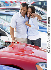 Young couple shopping for a new car
