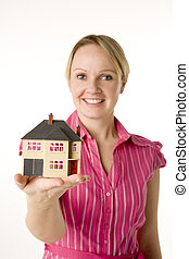 Businesswoman Holding Small House