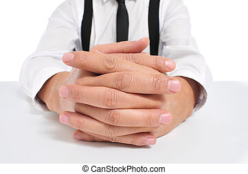 businessman with clasped hands - businessman sitting in a...