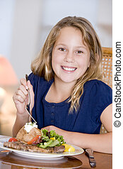 Young Girl Eating meal,mealtime