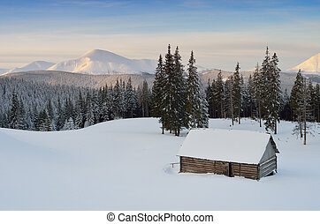 Mountain Hut - Winter in the mountain valley. Snowy...