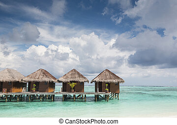 Small wooden houses on sea