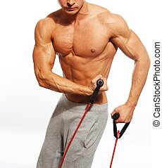 Handsome man with muscular body doing fitness exercise