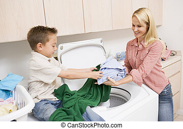 Mother And Son Doing Laundry