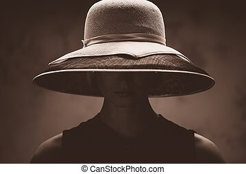 Young woman in big hat