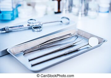 Dental tools and syringe at dentist's surgery