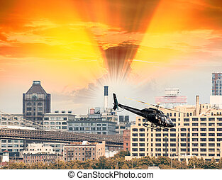 Black Helicopter hovering over New York buildings