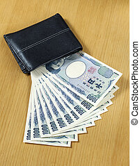 ten peices of one thousand Japanese cashes wallet close up