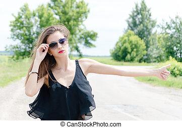 Beautiful hitch hiker - Beautiful young woman standing by...