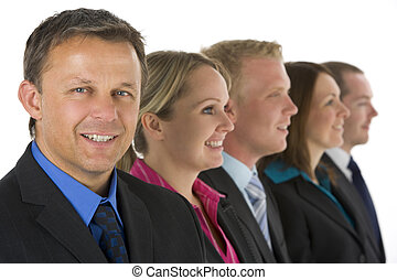 Group Of Business People In A Line Smiling