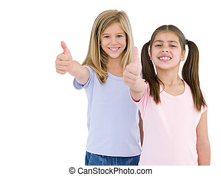 Two girl friends giving thumbs up smiling