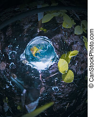 Green energy concept, Fresh Earth in a water drop