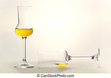 Two Grappa glasses - Two partly filled Grappa glasses very...