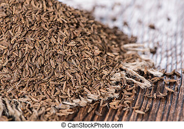 Heap of Caraway on vintage wooden background macro shot