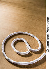 Telephone Cord Making \'At\' Symbol