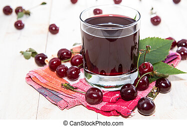 Fresh made Cherry Juice on wooden background
