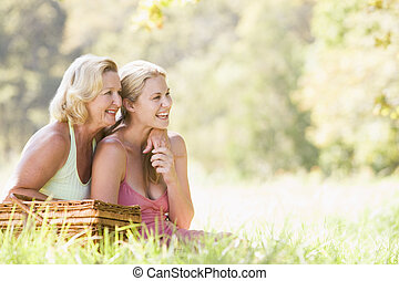 Mother with adult daughter on picnic