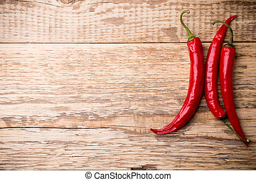 Chili pepper. - Chili pepper on the wooden background.
