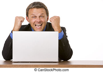 Businessman Cheering At Laptop