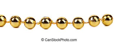 Decorative golden beads. Horisontal. Isolated on a white...