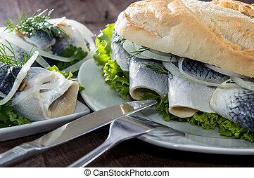 Herring Filet on a baguette (against wood) - Herring Filet...