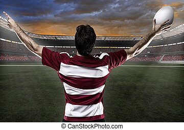 Rugby player in a red uniform celebrating. White Background