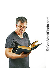 man reading in a law book