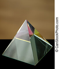 Glass prism as a pyramid with colorful reflections - The...