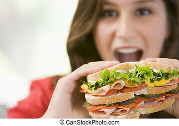 Teenage Girl Eating Sandwich