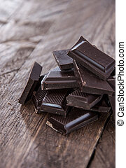Heap of Chocolate on wooden background