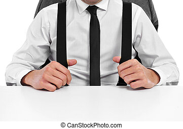businessman in the office - a businessman with suspenders...