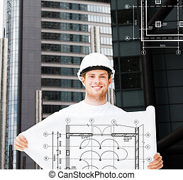 male architect in white helmet with blueprint