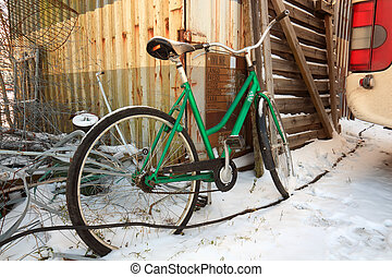 bike in a snowdrift in a rural area