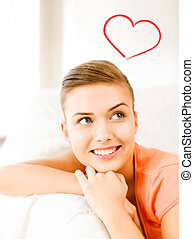 smiling woman lying on the couch - happiness and love...