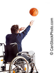 Disabled throwing basketball - A disabled man on a...