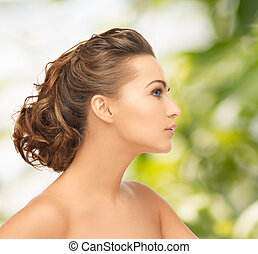 beautiful woman with updo - health and beauty concept - face...
