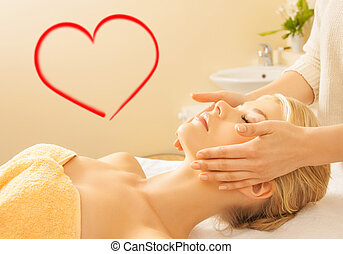 woman in spa salon getting facial - spa, beauty, resort and...