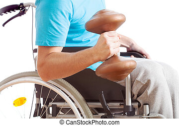 Handicapped working out - A handicapped man on a wheelchair...