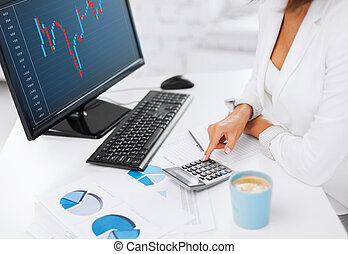 woman hand with calculator, papers and monitor - business,...